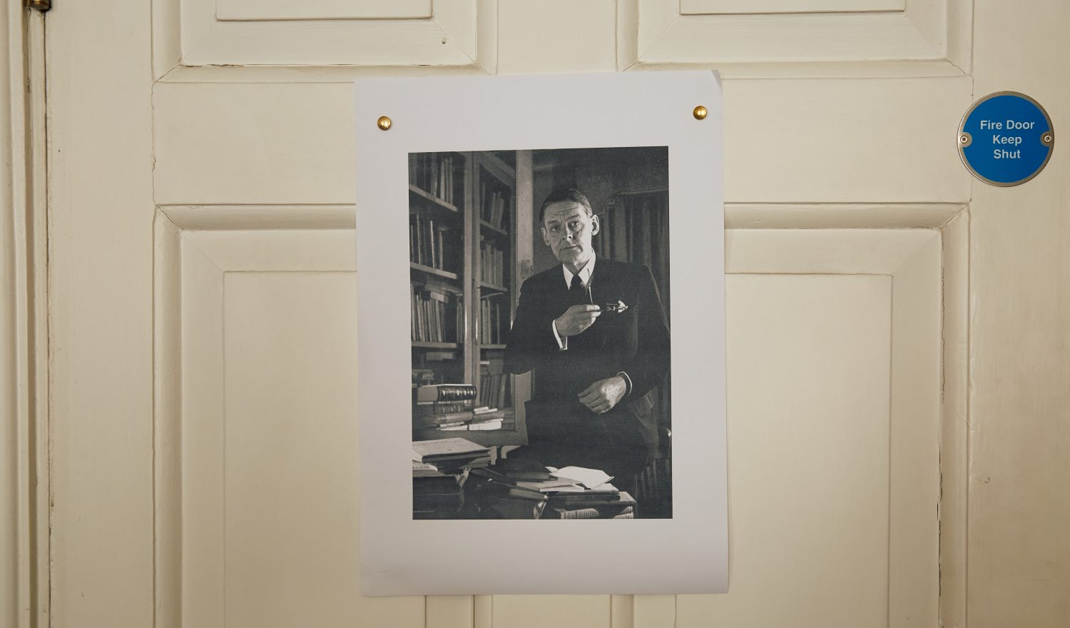 Picture of TS Eliot pinned to the back of a door
