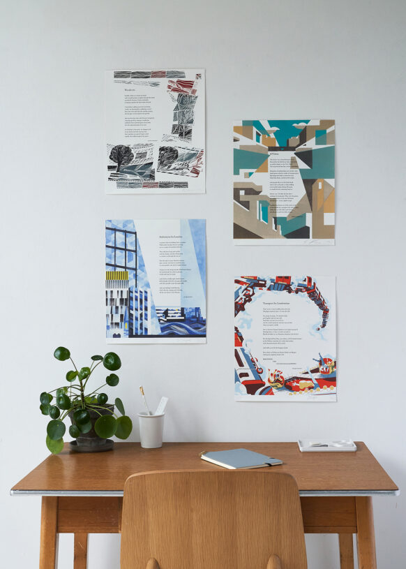 Poetry broadsides above desk on wall